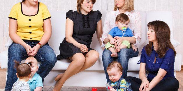 women talking  their children...