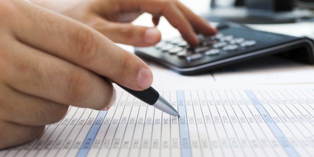 Accountant checking numbers on a document