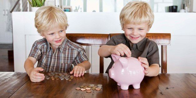 Twin boys and piggy bank
