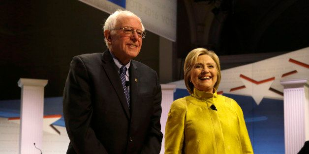 Democratic presidential candidates Sen. Bernie Sanders, I-Vt, left, and Hillary Clinton smile as they take the stage before a