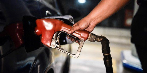 CARACAS, VENEZUELA -FEBRUARY 17: A worker puts gasoline to a vehicle in Caracas, Venezuela on February 17, 2016. Venezuela's