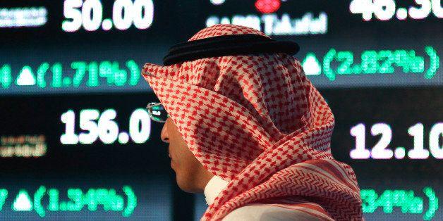 A Saudi man walks at the Tadawul Saudi Stock Exchange, in Riyadh, Saudi Arabia, Monday, June 15, 2015. Saudi Arabia's stock m