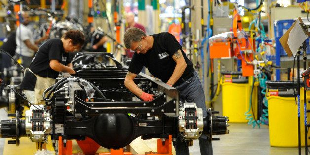 In this photo taken Aug. 12, 2015, workers assemble a truck at Ford Motor Company's Ohio Assembly Plant Wednesday, Aug. 12,