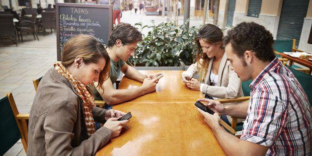 Friends having tapas at restaurant
