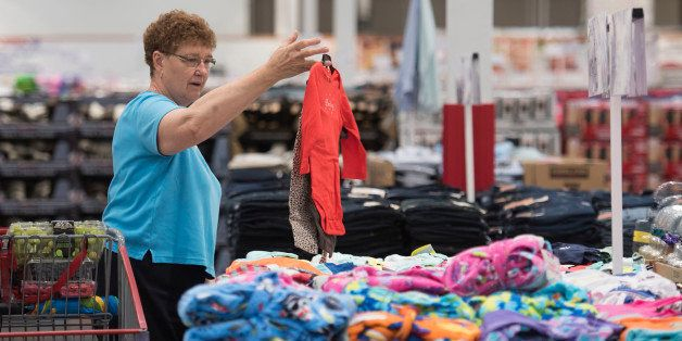Linda Wentzel shops for clothing at a Costco Wholesale Corp. store in East Peoria, Illinois, U.S., on Tuesday, May 26, 2015.