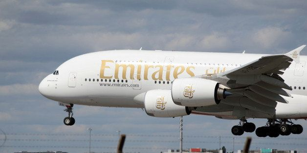 A Emirates Airbus A380 plane lands at Heathrow Airport