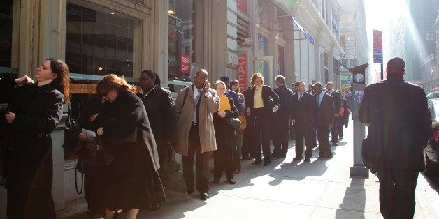 UNITED STATES - APRIL 02:  Job seekers line up outside of the Metropolitan Pavilion for a Careerbuilder.com career fair in Ne