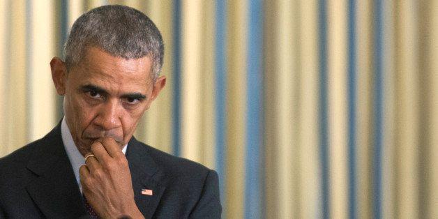 WASHINGTON, DC - MARCH 30:  U.S. President Barack Obama listens as Vice President Joe Biden speaks during the Easter Prayer B