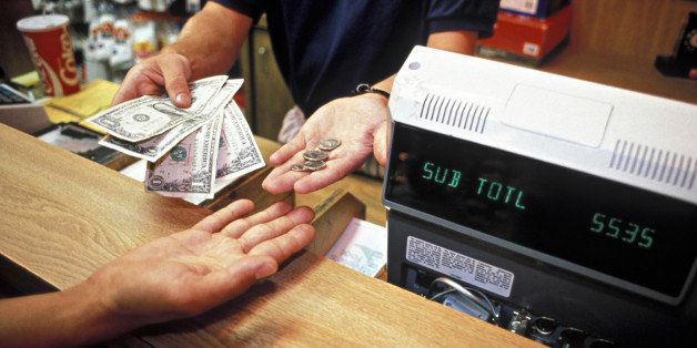RETAIL CLERK GIVES CHANGE TO CUSTOMER. CASH REGISTER SEEN. PARAMUS, NEW JERSEY. (*) H