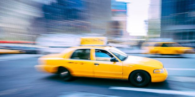 New York Yellow Taxi heading uptown.