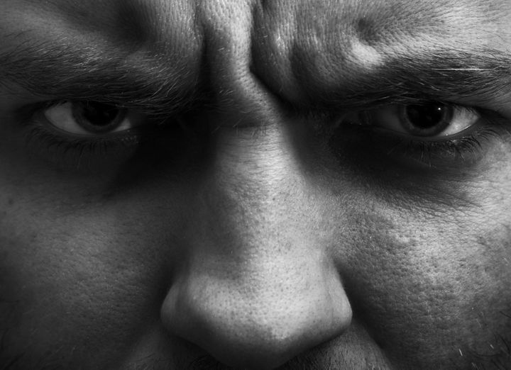 Close-up portrait of angry man. In B/W