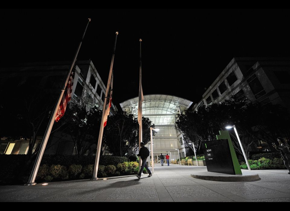 CUPERTINO, CA - OCTOBER 05:  Flags fly at half staff following the death of Steve Jobs at the Apple headquarters on October 5