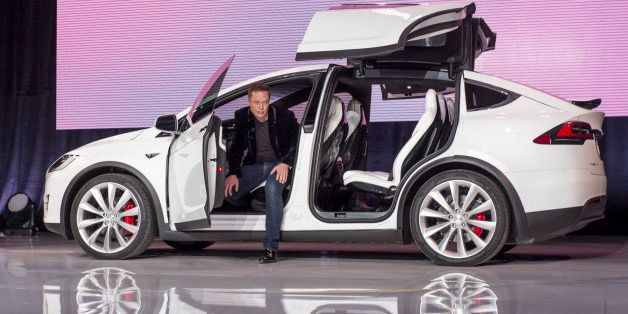 Elon Musk, chairman and chief executive officer of Tesla Motors Inc., exits the Model X sport utility vehicle (SUV) during an