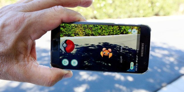 """The augmented reality mobile game """"Pokemon Go"""" by Nintendo is shown on a smartphone screen in this photo illustration taken i"""