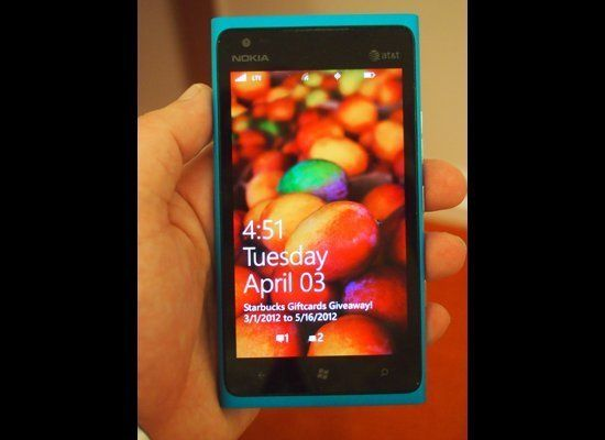 The lock screen, with event and message notifications, on the Lumia 900.