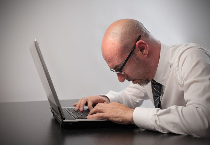 bored businessman using a laptop