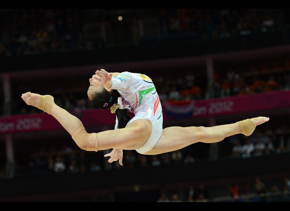 China's gymnast Deng Linlin performs during the women' s beam final of the artistic gymnastics event of the London Olympic Ga