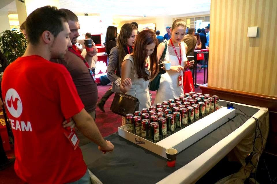 Webstock 2012 participants interact with the beer keyboard.