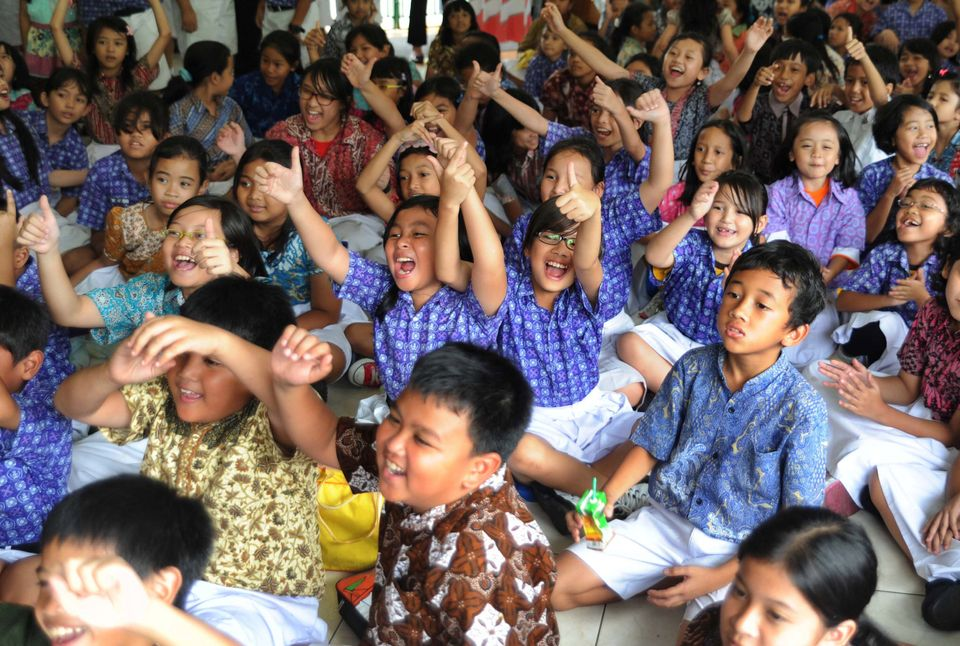 Indonesian school children erupt into cheers on hearing the announcement that U.S. President Barack Obama had won the U.S. pr