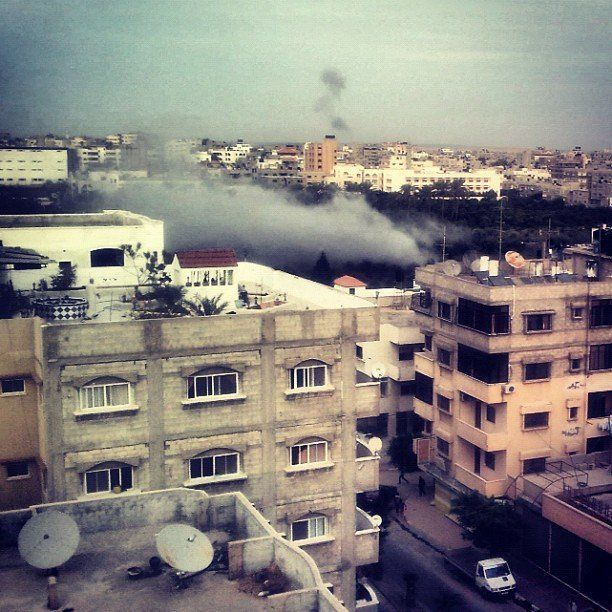 """Right Now. Photo taken from my apartment showing another explosion from the Israeli attacks on Gaza. Now this is too close t"