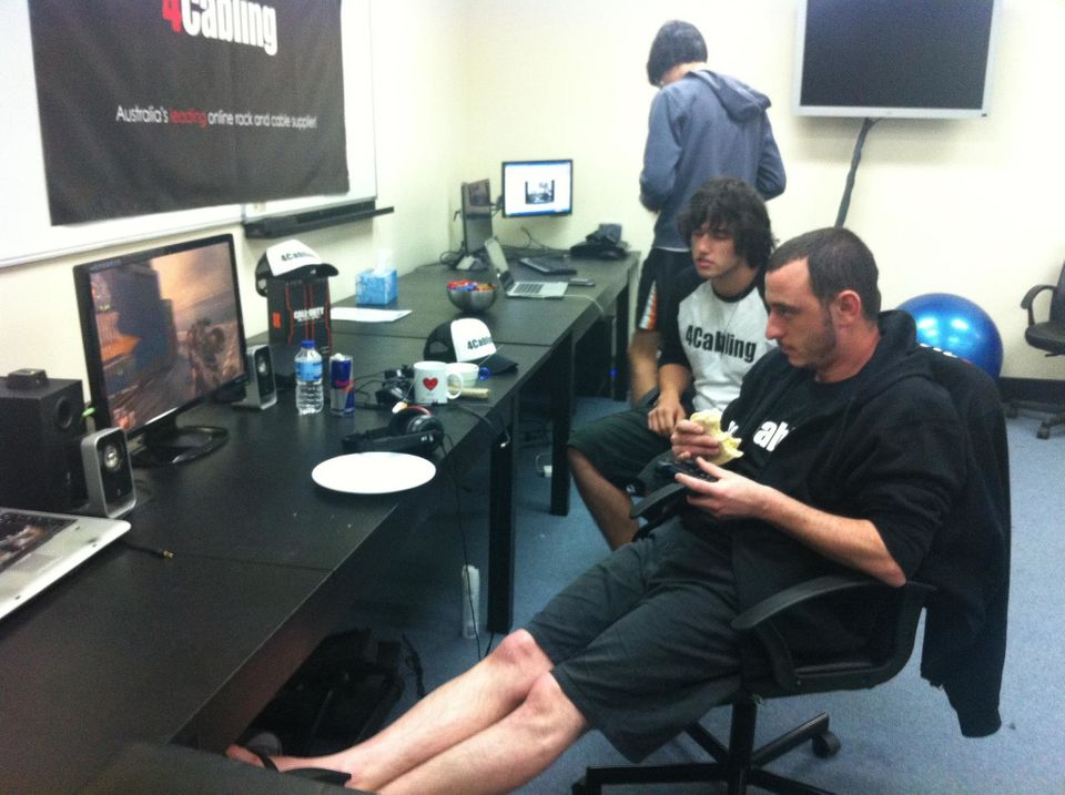 """Okan Kaya eats while playing """"Call of Duty: Black Ops 2"""" in his world record attempt."""