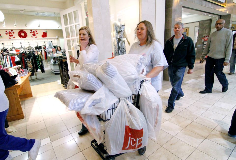 Laura Whitty of Harrisville, Miss., left, and Janice Barnett of Jayess, Miss. push a shopping cart through Northpark Mall in