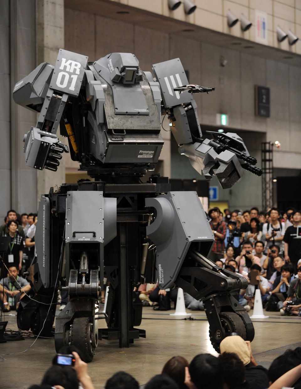 Japanese electronics company Suidobashi Heavy Industry unveils its latest robot 'Kuratas' (C) as a crowd of people take photo