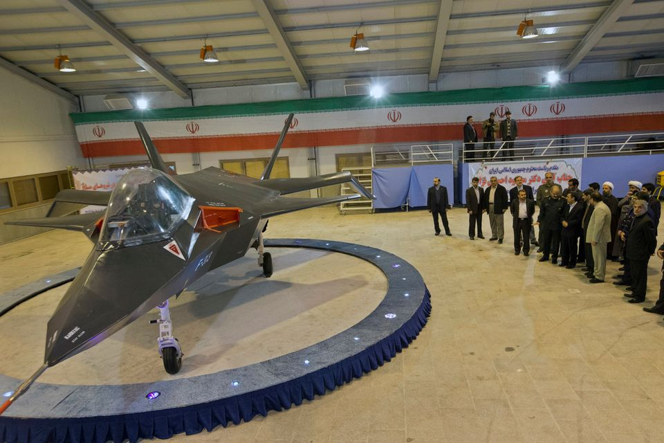 Iran's newest fighter jet, Qaher-313, or Dominant-313, is unveiled by Iranian President Mahmoud Ahmadinejad, accompanied by t