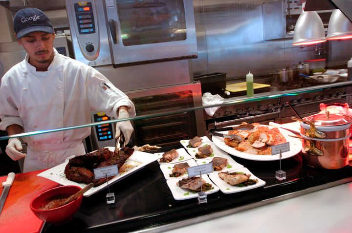 UNITED STATES - MAY 16:  Grill cook Antonio Paez tends to a beef tri-tip in a cafeteria at Google Inc. in Mountain View, Cali