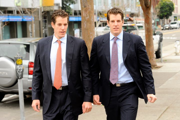 Cameron Winklevoss, left, and his twin brother Tyler leave a federal appeals court in San Francisco, California, U.S., on Tue