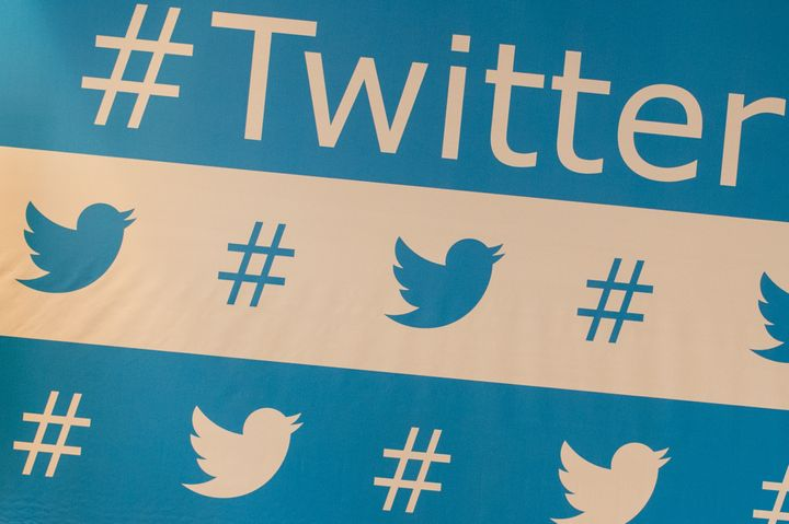 TO GO WITH AFP STORY BY NATALIA RAMOS Twitter's brand marks are seen as background of the speakers during their press confere
