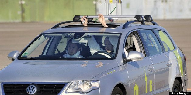 The driverless car 'Made in Germany' (MIG), which from the outside looks like a regular Volkswagen Passat with a camera on to