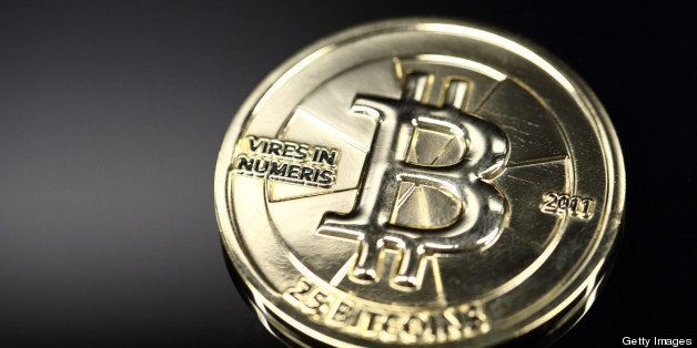 A twenty-five bitcoin is arranged for a photograph in Tokyo, Japan, on Thursday, April 25, 2013. The digital currency, which