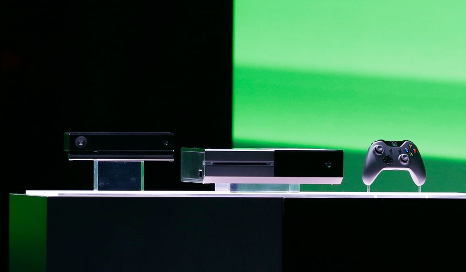 Microsoft Corp.'s next-generation Xbox One entertainment and gaming console system is shown on stage Tuesday, May 21, 2013, a