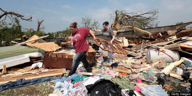 SHAWNEE, OK - MAY 20:  Candice Lopez (L) and Stephanie Davis help clean debris from Thelma Cox's mobile home after it was des