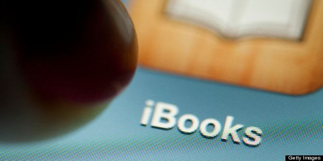 A digital book is displayed on an Apple Inc. iPad for a photograph in New York, U.S., on Wednesday, April 11, 2012. Apple Inc. and two publishers, Macmillan and Penguin, were accused by the U.S. Justice Department of conspiring to fix prices of digital books to undermine Amazon.com Inc.'s dominance of the industry. Photographer: Scott Eells/Bloomberg via Getty Images