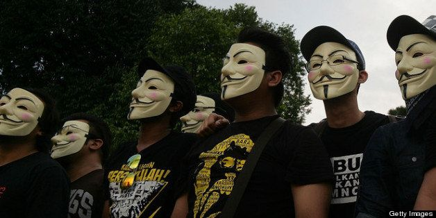 KUALA LUMPUR, MALAYSIA - MAY 25: :Political activists wear anonymous masks during a political rally against election fraud on