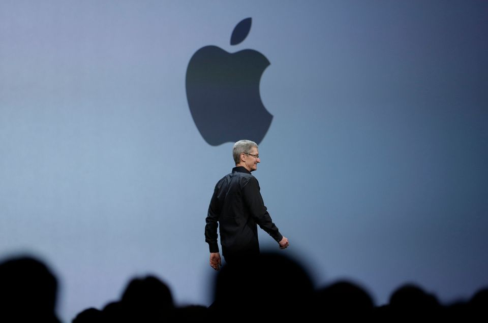 Apple CEO Tim Cook walks on stage to deliver the keynote address of the Apple Worldwide Developers Conference, Monday, June 1