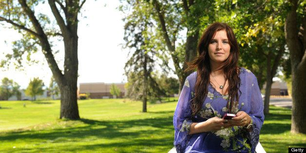 29-year-old Allison Silva uses the phone app HowAboutWe to meet people for dating. She was at an Aurora Park on Thursday, Sep