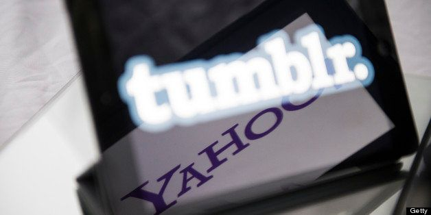 A picture taken on May 20, 2013 in Paris, shows logos of the brands Tumblr and Yahoo! on the screen of tablets. Yahoo! bought