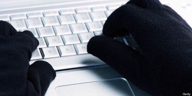 IT Crime consept Hacker works on laptop