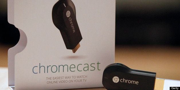 The new Google ChromeCast is displayed for a photograph during an event in San Francisco, California, U.S., on Wednesday, Jul