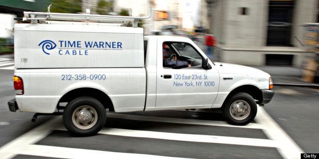 UNITED STATES - OCTOBER 18:  A Time Warner Cable trucks turns a corner on a New York street Wednesday, October 18, 2006 Time