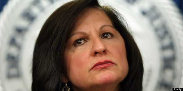 BOSTON - JANUARY 17: US Attorney Carmen Ortiz listens intently to a reporters question about the suicide death of Aaron Swart