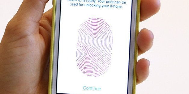 CUPERTINO, CA - SEPTEMBER 10:  The new iPhone 5S with fingerprint technology is displayed during an Apple product announcemen