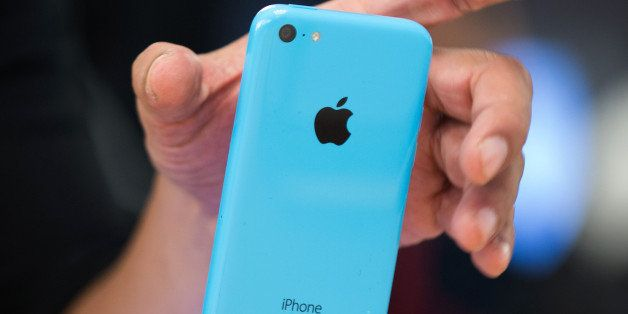 A customer views an Apple Inc. iPhone 5c displayed during the devices launch at the company's store in New York, U.S., on Fri