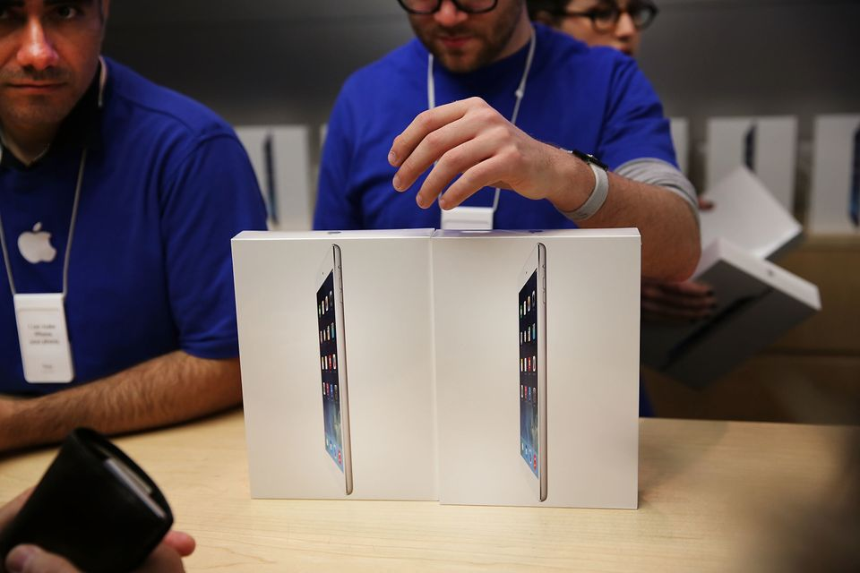 NEW YORK, NY - NOVEMBER 01: Apple employees sell the new iPad Air at the Apple Store on November 1, 2013 in New York City. Th
