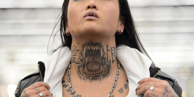 FRANKFURT AM MAIN, GERMANY - MARCH 22:  Marlin (35) shows her Pitbull-Tattoo on her neck during the International Tattoo Conv