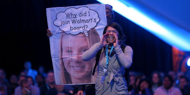 SAN FRANCISCO, CA - NOVEMBER 19:  A protester shouts as Yahoo CEO Marissa Mayer speaks in conversation with Salesforce chairm