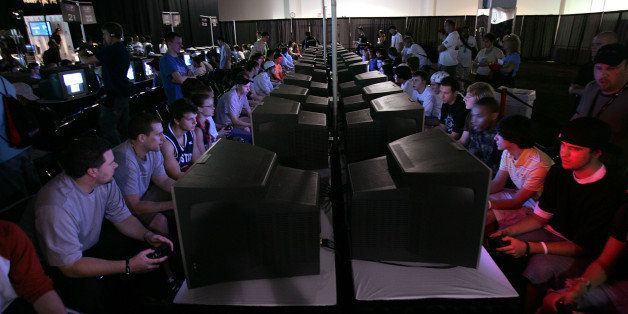 EAST RUTHERFORD, NJ - JUNE 08:  Competitors play video games on monitors during the Major League Gaming Pro Circuit event Jun